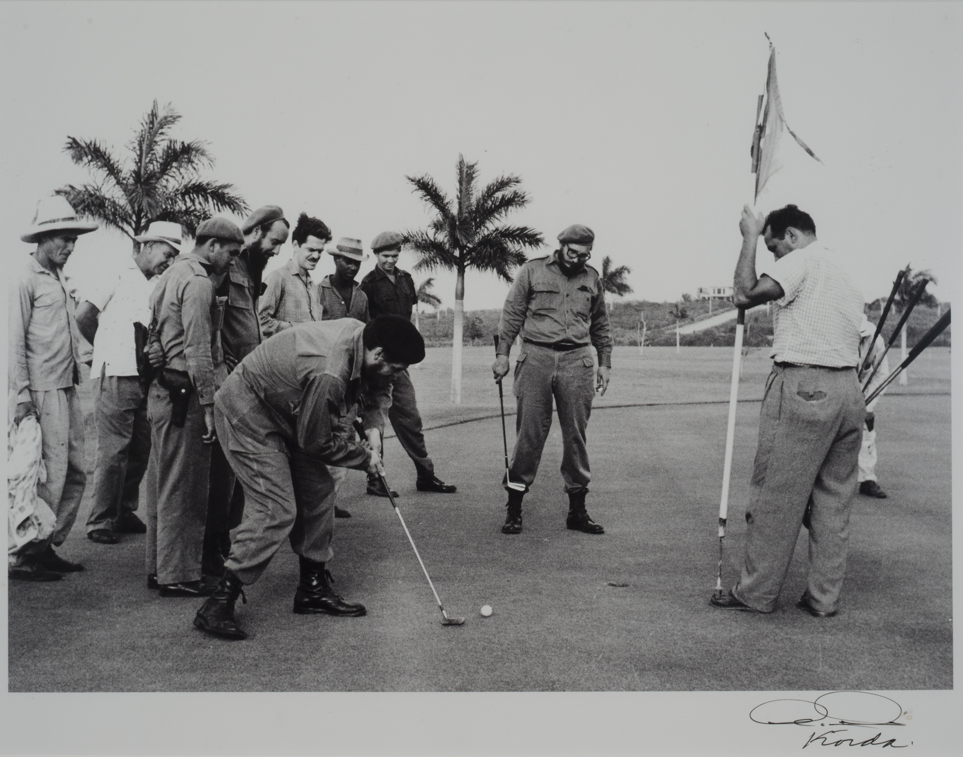 Che Guevara playing golf with Fidel Castro by Korda (1959)
